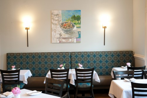 Soft lighting and comfortable Ct.-made banquette with original local art.