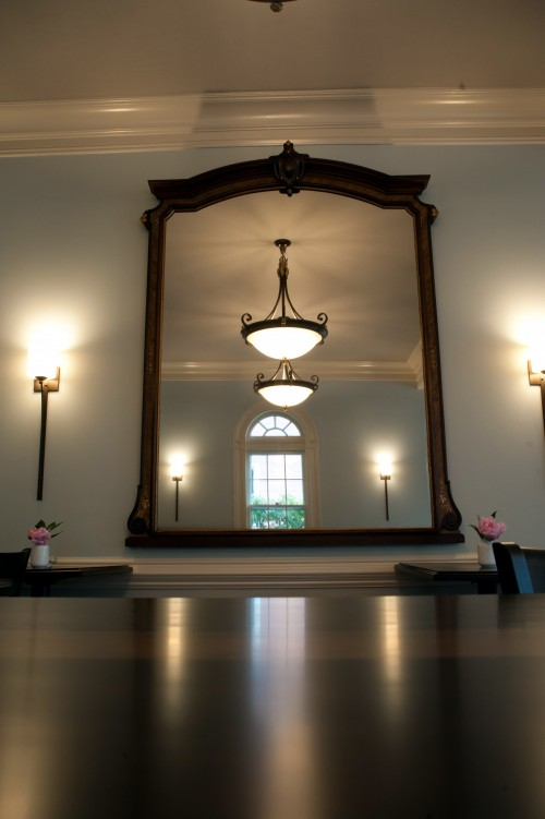 A mirror from the old Bank was reused as a focal point to reflect the light coming in from the south windows.